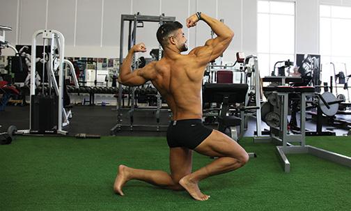 miguel-lopez-posing-biceps-back