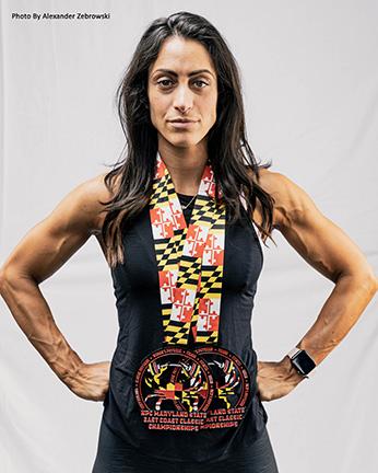 alexandra-antonio-two-medals-around-neck